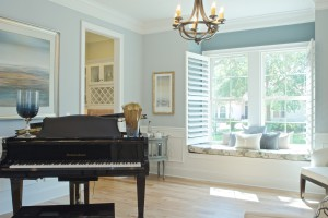 Showhome interior piano and window seat